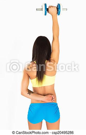 Una joven musculosa con pesas - csp20495286
