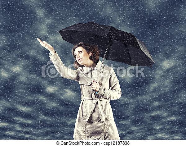 Una chica con paraguas - csp12187838