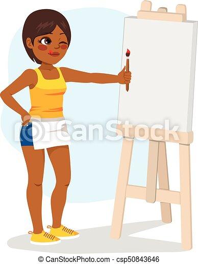 Una chica pintando lona - csp50843646