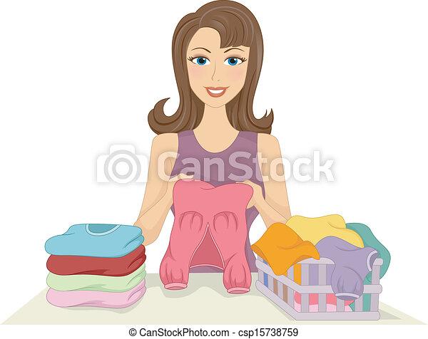 Chica doblando ropa - csp15738759