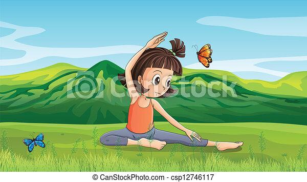 Una chica haciendo yoga cerca de las colinas - csp12746117