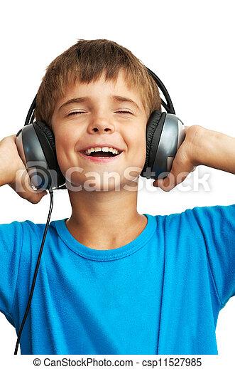 El chico está sosteniendo los auriculares - csp11527985