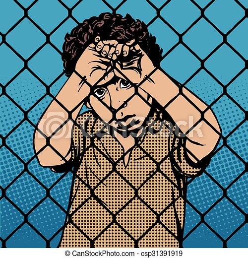 Niños inmigrantes refugiados tras las rejas del límite de la prisión - csp31391919