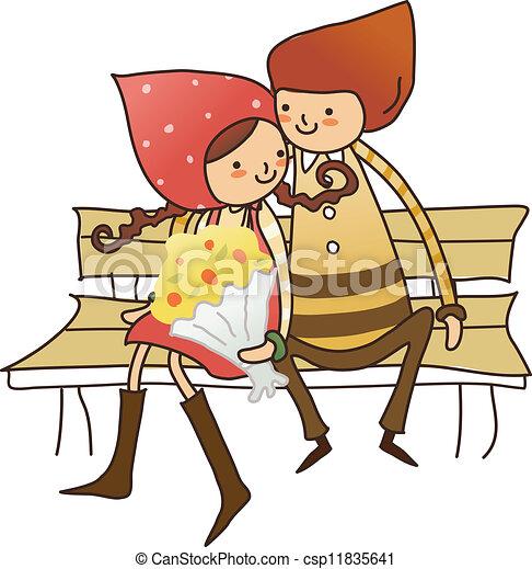 Niño y Chica sentados en el banquillo - csp11835641