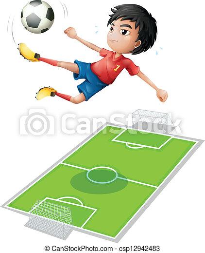 Un chico pateando la pelota - csp12942483