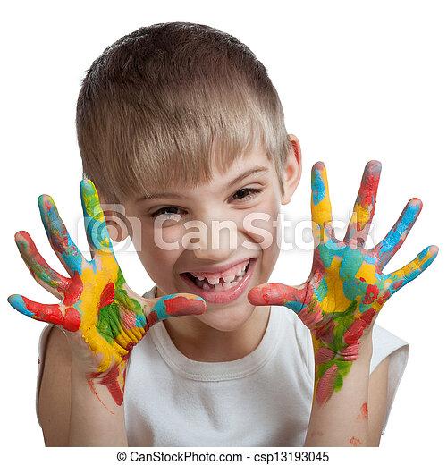 El chico asusta sus manos manchadas de pintura - csp13193045