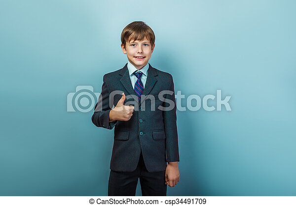 Un chico de negocios con pulgares arriba - csp34491709