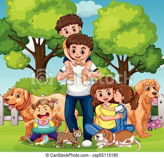 Familia con niños y mascotas en el parque - csp55115180