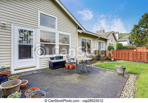Nice backyard with patio and chairs. - csp28523012