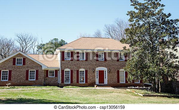 Nice Brick Two Story with Red Door - csp13056159