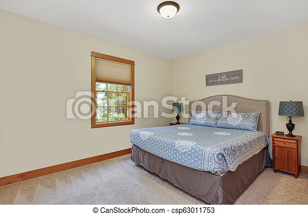 Nice Guest Room Interior With Light Yellow Walls Nice Guest Room Features Linen Headboard With Nailhead Trim On King Bed And Canstock