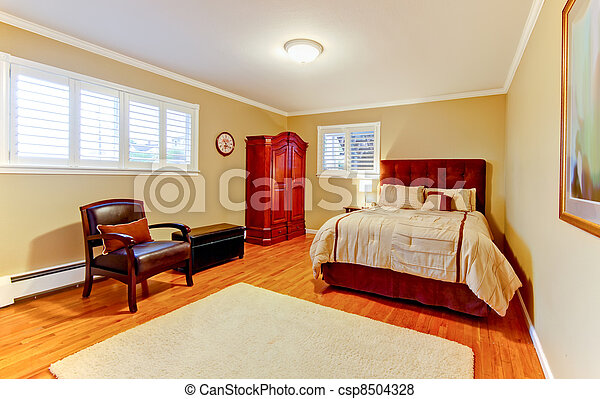 Nice large bedroom with red mahogany wood.
