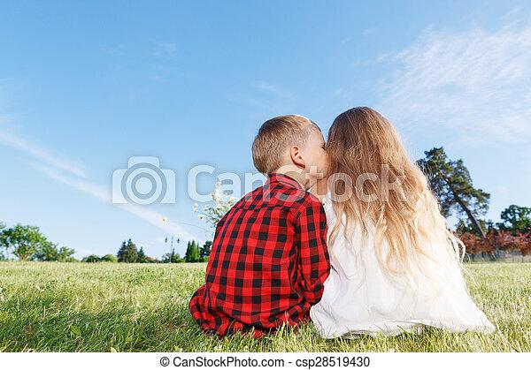 Nice little girl and boy sitting backwards  - csp28519430