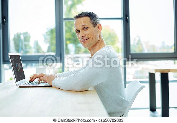 Nice pleasant man studying global market - csp50782803