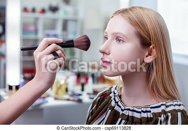 Nice pretty woman being in the beauty studio - csp69113828