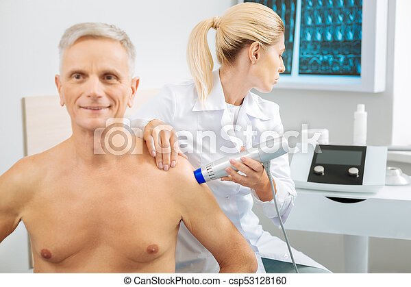 Nice professional doctor looking at the monitor - csp53128160