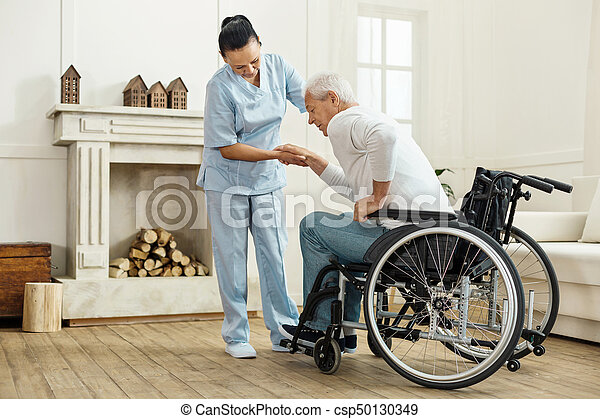 Nice senior man getting out from the wheelchair - csp50130349