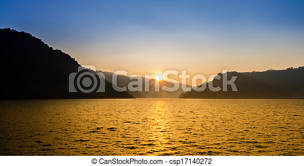Nice sunrise over mountain and lake - csp17140272