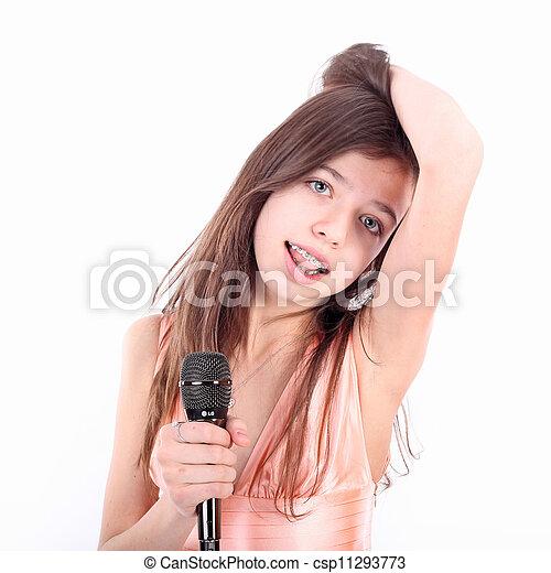Nice Teen Girl With Microphone Singing Csp11293773