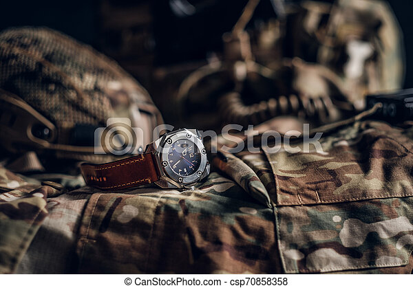 Nice Watch With Military Uniform On The Table