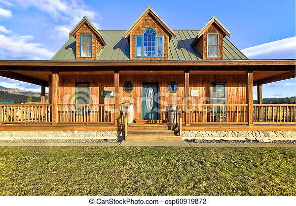 Nice wooden ranch home with beautiful landscape in the countryside. - csp60919872