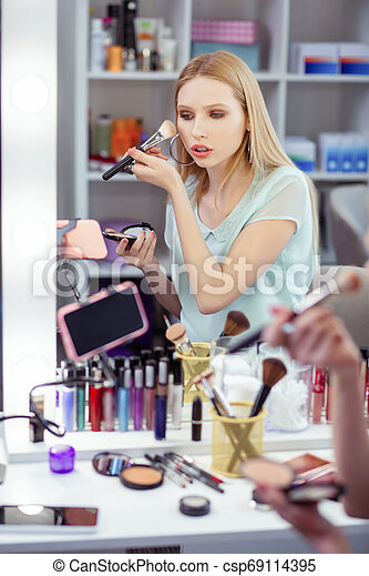 Nice young woman having her beauty blog - csp69114395