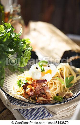 Nicely served spaghetti carbonara on black background - csp45443879