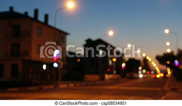 Night city scene, road, defocused background. - csp58534951