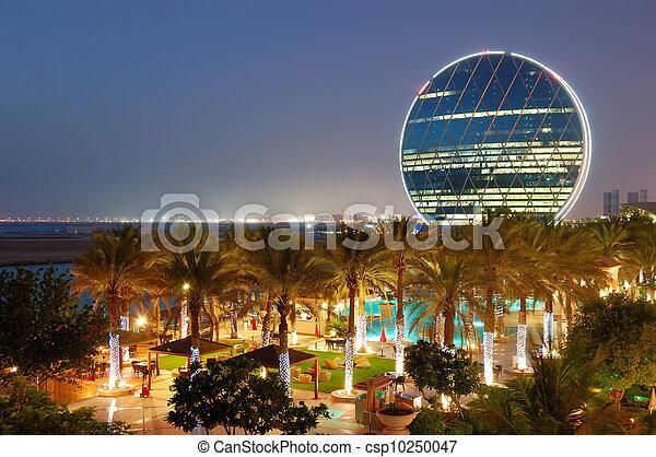 Night illumination in the luxury hotel and circular building, Abu Dhabi, UAE - csp10250047