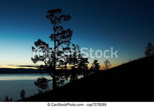 Night landscape against a decline lake Baikal - csp7378269