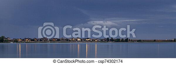 night over a calm lake in Colorado - csp74302174