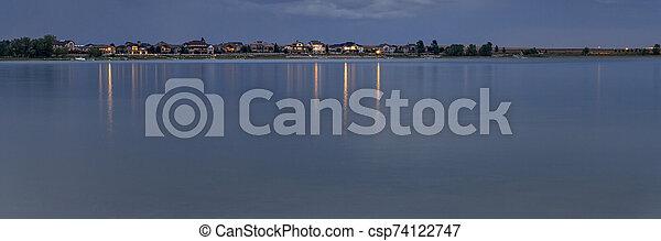 night over a calm lake in Colorado - csp74122747