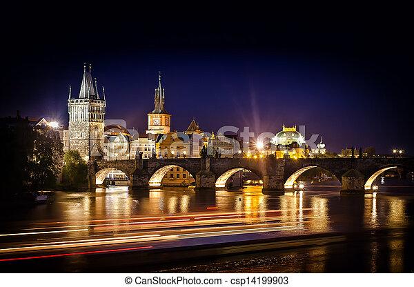 Night shot of Charles Bridge and river in Prague - csp14199903