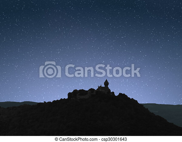 Night sky sunrise with castle on hill - csp30301643