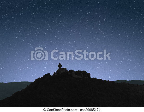Night sky sunrise with castle on hill - csp39085174