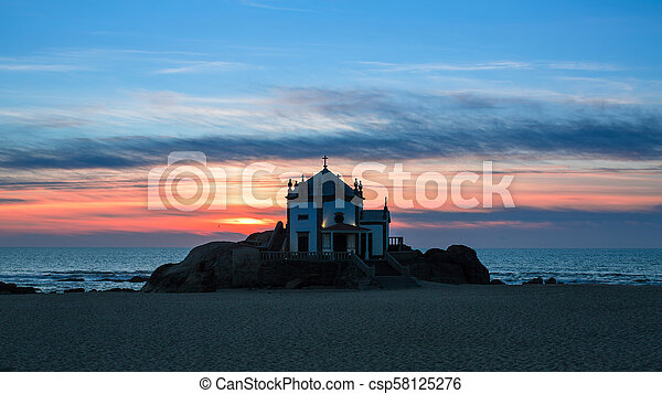 Night view of Chapel Senhor da Pedra at Miramar Beach, Porto, Portugal. - csp58125276