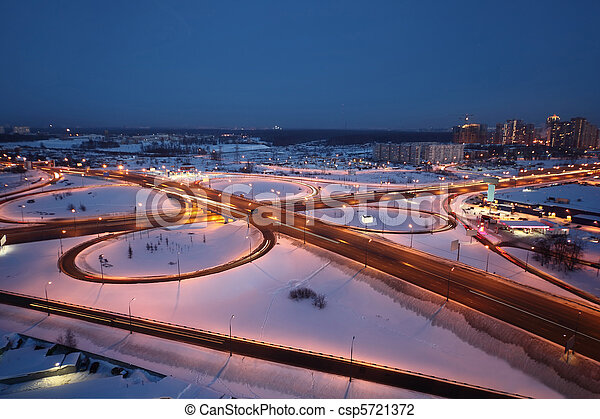 night winter cityscape with big interchange and lighting columns - csp5721372
