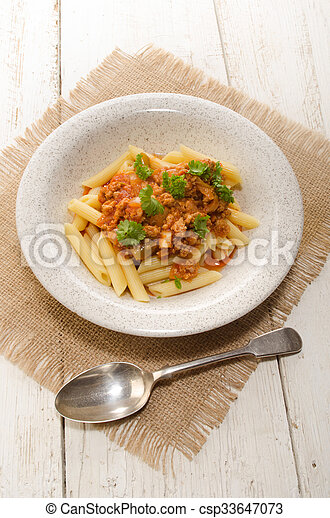 noodle with minced meat and parsley on a plate - csp33647073