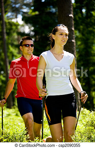 nordic walking in forest - csp2090355