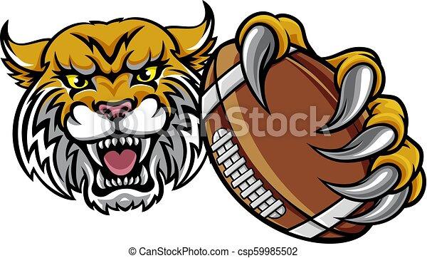 Wildcat sosteniendo la pelota de fútbol americano - csp59985502