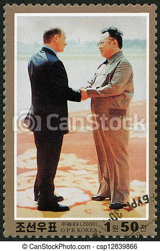 NORTH KOREA - CIRCA 2000: A stamp printed in North Korea shows Kim Jong Il and President Putin, Visit of Kim Jong Il to Russia, circa 2000 - csp12839866