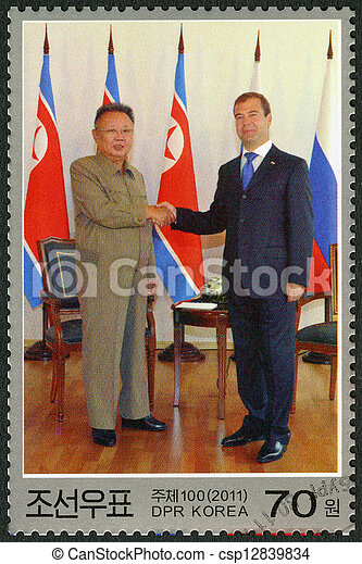 NORTH KOREA - CIRCA 2011: A stamp printed in North Korea shows Kim Jong Il and President Medvedev, Visit of Kim Jong Il to Russia, circa 2011 - csp12839834
