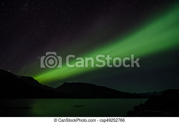 Northern lights at night over a lake in Igaliko - csp49252766