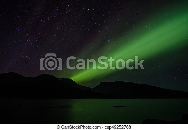 Northern lights at night over a lake in Igaliko - csp49252768