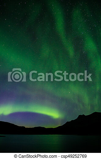Northern lights at night over a lake in Igaliko - csp49252769