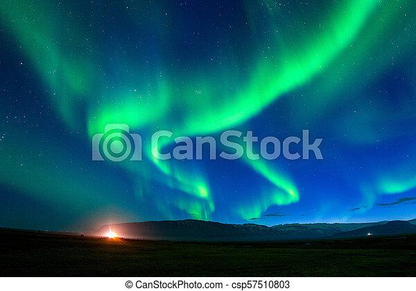Northern lights (Aurora borealis) at night. - csp57510803