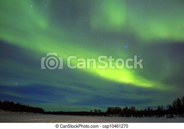 Northern Lights (Aurora borealis) over snowscape.  - csp10461270