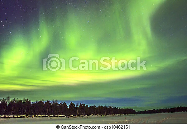 Northern Lights (Aurora borealis) over snowscape. - csp10462151