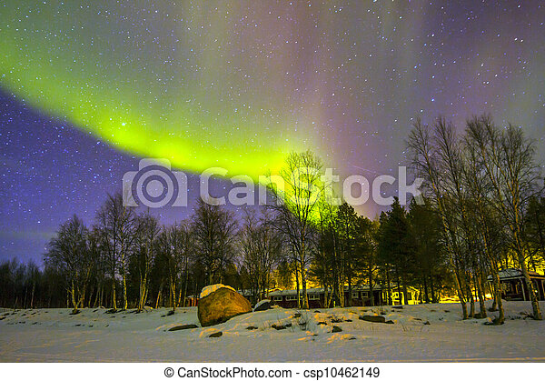 Northern Lights (Aurora borealis) over snowscape. - csp10462149