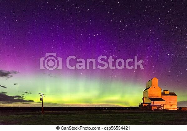Northern Lights over a historic grain elevator in Saskatchewan, Canada - csp56534421